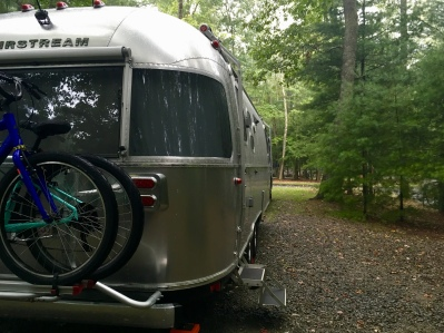 Airstream parked at our wooded campsite