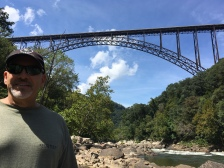 Dan with ground level view of the bridge