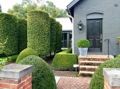 Manicured shrubs in front a home in exclusive German Village area